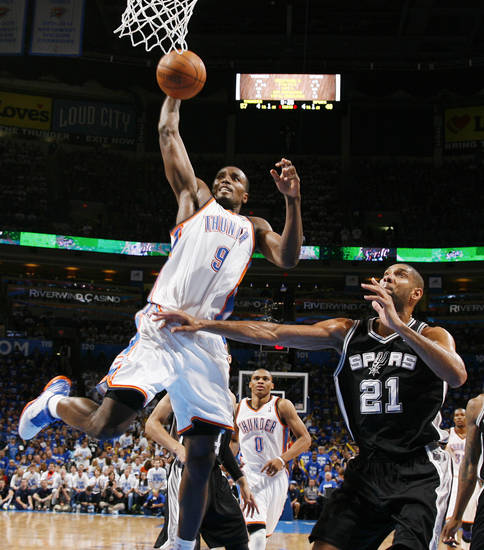 Oklahoma City's Serge Ibaka (9) dunks against San Antonio's Tim Duncan (21) in the second half during Game 4 of the Western Conference Finals between the Oklahoma City Thunder and the San Antonio Spurs in the NBA playoffs at the Chesapeake Energy Arena in Oklahoma City, Saturday, June 2, 2012. Oklahoma City won, 109-103. Photo by Nate Billings, The Oklahoman