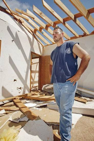 Blanchard volunteer firefighter Lonnie Bewley surveys damage to his house sustained in Tuesday's tornado while he was out helping others. PHOTO BY STEVE SISNEY, THE OKLAHOMAN <strong>STEVE SISNEY</strong>