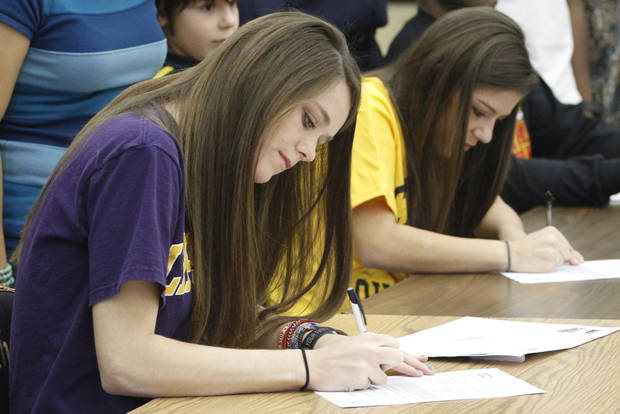 Putnam City North's Molly Bray, left and Kylee Warne signed letters of intent during a ceremony in Oklahoma City, Wednesday, February  1, 2012. Bray signed with Lipscomb University and Warne signed with the University of Central Oklahoma. Photo By Steve Gooch, The Oklahoman