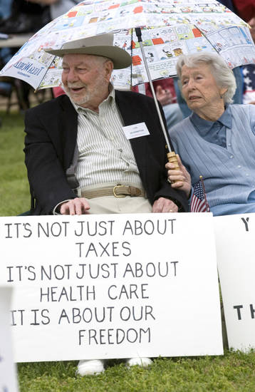 De and Shirley Hampton, of Grove, brave the cold and rainy weather Saturday to attend the Tea Party at the Grove Community Center in Grove.  PHOTO BY GARY CROW, FOR THE OKLAHOMAN