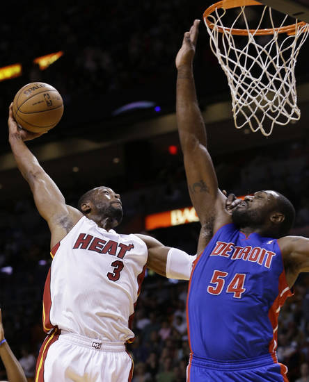 Miami Heat guard Dwyane Wade (3) goes up for a shot against Detroit Pistons forward Jason Maxiell (54) during the first half of an NBA basketball game, Friday, Jan. 25, 2013, in Miami. (AP Photo/Wilfredo Lee)