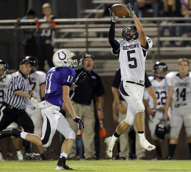 Perkins' Matt Waitt makes a catch in front of Bethany's Zech Kalfas during the high school football game between Bethany High School and Perkins in Bethany, Okla., Friday, Sept. 28, 2012.  Photo by Sarah Phipps, The Oklahoman