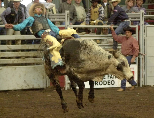 Cord McCoy rides a bull during the State Fair Rodeo finals at State Fair Arena Sunday. Staff photo by Nate Billings.