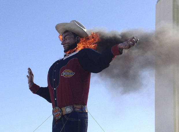 Fire begins to engulf the Big Tex displayed at the State Fair of Texas  Friday, Oct. 19, 2012, in Dallas. The iconic structure was destroyed Friday when flames engulfed his 52-foot-tall frame. (AP Photo/LM Otero) ORG XMIT: TXMO113