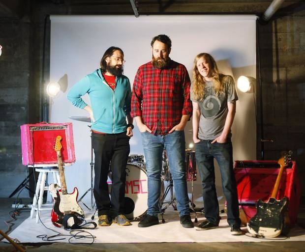 """Oklahoma rock band Colourmusic, composed of members Ryan Hendrix (left), Nicholas Ley (center), and Corey Ray (right), pose for a picture after rehearsing in an art studio in Midtown Oklahoma City on Thursday, March 27, 2014. The band released their eccentric new album """"May You Marry Rich"""" on March 24, 2014. Photo by KT King, The Oklahoman"""