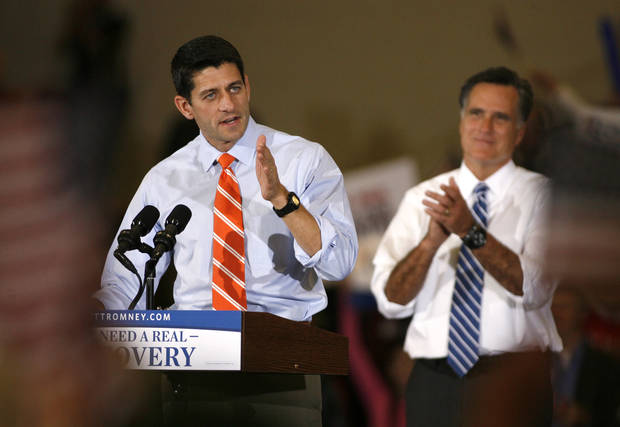 Republican vice presidential candidate Rep. Paul Ryan, R-Wis., makes a point as Republican presidential candidate former Massachusetts Gov. Mitt Romney applauds at a campaign rally at the Marion County Fairgrounds in Marion, Ohio, on Sunday, Oct. 28, 2012. (AP Photo/Mike Munden)