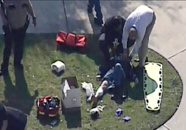 In this frame grab provided by KPRC Houston, an unidentified person is attended to by emergency personnel at Lone Star College Tuesday, Jan. 22, 2013, in Houston, where law enforcement officials say the community college is on lockdown amid reports of a shooter on campus.  (AP Photo/Courtesy KPRC TV) MANDATORY CREDIT ORG XMIT: CER102