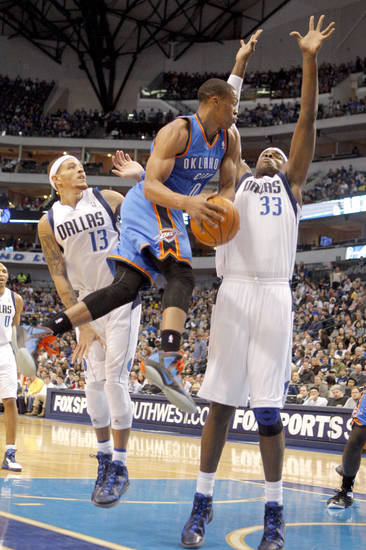 NBA BASKETBALL / DALLAS MAVERICKS: Oklahoma City's Russell Westbrook (0) shoots a layup as Dallas' Brendan Haywood (33) defends  during the preseason NBA game between the Dallas Mavericks and the Oklahoma City Thunder at the American Airlines Center in Dallas, Sunday, Dec. 18, 2011. Photo by Sarah Phipps, The Oklahoman