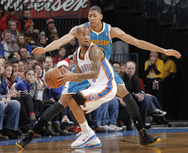 New Orleans Hornets' Anthony Davis (23) defends on Oklahoma City Thunder's Eric Maynor (6) during the NBA basketball game between the Oklahoma CIty Thunder and the New Orleans Hornets at the Chesapeake Energy Arena on Wednesday, Dec. 12, 2012, in Oklahoma City, Okla.   Photo by Chris Landsberger, The Oklahoman