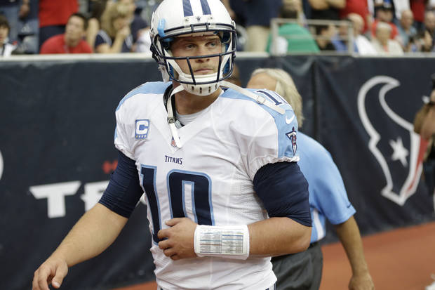 Tennessee Titans' Jake Locker (10) leaves the game after being injured on a sack by Houston Texans' Glover Quin in the first quarter of an NFL football game Sunday, Sept. 30, 2012, in Houston. (AP Photo/Eric Gay)
