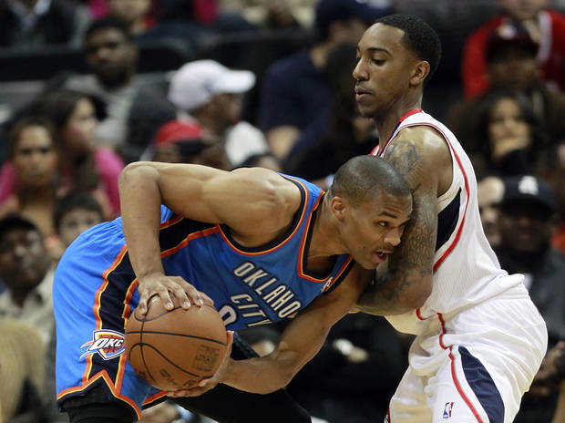 Oklahoma City Thunder guard Russell Westbrook (0) drives against Atlanta Hawks guard Jeff Teague (0) in the second half of an NBA basketball game Saturday, March 3, 2012 in Atlanta. Atlanta won 97-90. AP Photo/John Bazemore) ORG XMIT: GAJB127