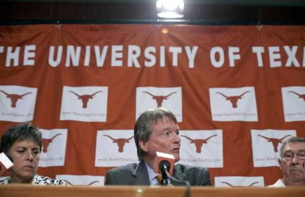 University of Texas women's athletic director Christine Plonsky, left, president William Powers, and men's athletic director DeLoss Dodds respond to questions during a news conference regarding the  Big  12  and Pac-10 conferences on Tuesday, June 15, 2010, in Austin, Texas. (AP Photo/The Daily Texan, Tamir Kalifa)