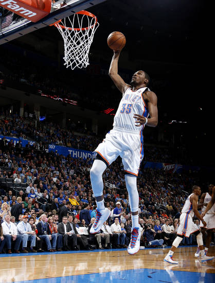 Oklahoma City's Kevin Durant (35) goes to the basket during an NBA basketball game between the Oklahoma City Thunder and the Golden State Warriors at Chesapeake Energy Arena in Oklahoma City, Wednesday, Feb. 6, 2013. Photo by Bryan Terry, The Oklahoman