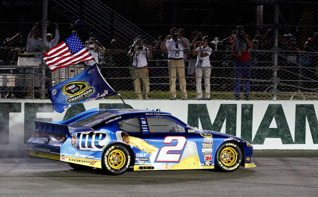 Brad Keselowski celebrates after the NASCAR Sprint Cup Championship auto race at Homestead-Miami Speedway, Sunday, Nov. 18, 2012 in Homestead, Fla. Keselowski clinched the Sprint Cup title after fellow title contender Jimmie Johnson pulled out of the season finale because of a parts failure. Jeff Gordon won the race. (AP Photo/J Pat Carter)