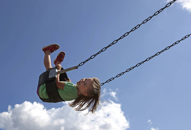 Marley Crowell, 3, swings at Mitch Park in Edmond, Okla., Sunday, May 13, 2012. Photo by Sarah Phipps, The Oklahoman