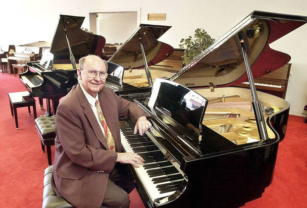 The late Albert Evans, owner of Albert Evans Piano Co., sits at a new piano in his store�s showroom on N MacArthur Blvd. in this photo from 2002.  Photo by JIM BECKEL, The Oklahoman Archives