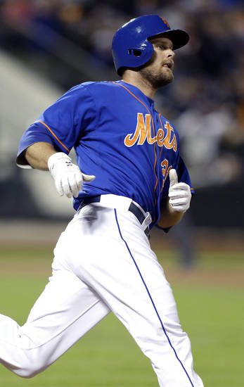 New York Mets' Lucas Duda trots the bases watching his fourth-inning solo home run off Atlanta Braves starting pitcher Julio Teheran in a baseball game against the Atlanta Braves at Citi Field in New York, Sunday, May 26, 2013. (AP Photo/Kathy Willens)