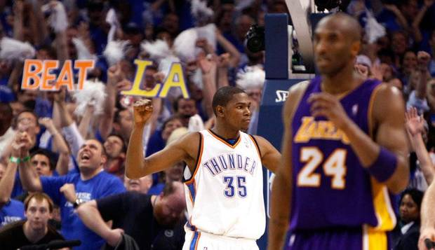 Oklahoma City's Kevin Durant celebrates as dejected Kobe Bryant (24) walks down court following the basketball game between the Los Angeles Lakers and the Oklahoma City Thunder in the first round of the NBA playoffs at the Ford Center in Oklahoma City, Thursday, April 22, 2010. Photo by Sarah Phipps, The Oklahoman