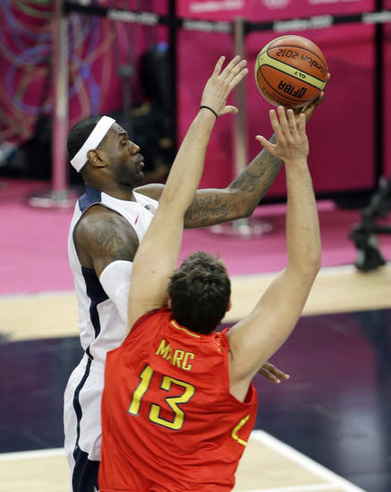United States&#039; LeBron James puts up a shot against Spain&#039;s Marc Gasol during the men&#039;s gold medal basketball game at the 2012 Summer Olympics, Sunday, Aug. 12, 2012, in London. (AP Photo/Matt Slocum)
