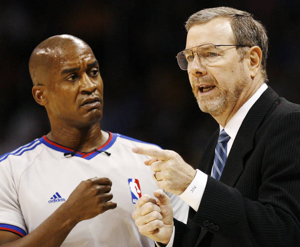 Thunder head coach P.J. Carlesimo talks to official Derrick Collins during the NBA basketball game between the Oklahoma City Thunder and the Milwaukee Bucks at the Ford Center in Oklahoma City, Wednesday, Oct. 29, 2008. This was the regular season debut of the Thunder. BY NATE BILLINGS, THE OKLAHOMAN