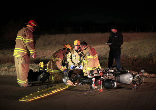 Edmond firefighters train after dark, responding to a vehicle accident scenario. Photo by Sarah Phipps, The Oklahoman <strong>SARAH PHIPPS - SARAH PHIPPS</strong>