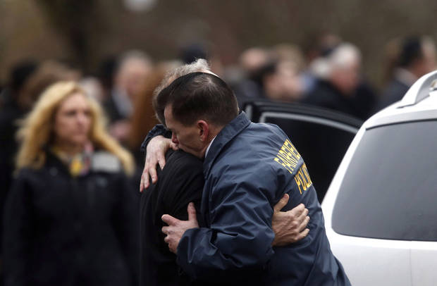 Fairfield police chief Gary MacNamara embraces a relative of Noah Pozner after a funeral service for the 6-year-old shooting victim, Monday, Dec. 17, 2012, in Fairfield, Conn.  Pozner was killed when a gunman walked into Sandy Hook Elementary School in Newtown Friday and opened fire, killing 26 people, including 20 children. (AP Photo/Jason DeCrow) ORG XMIT: CTJD116