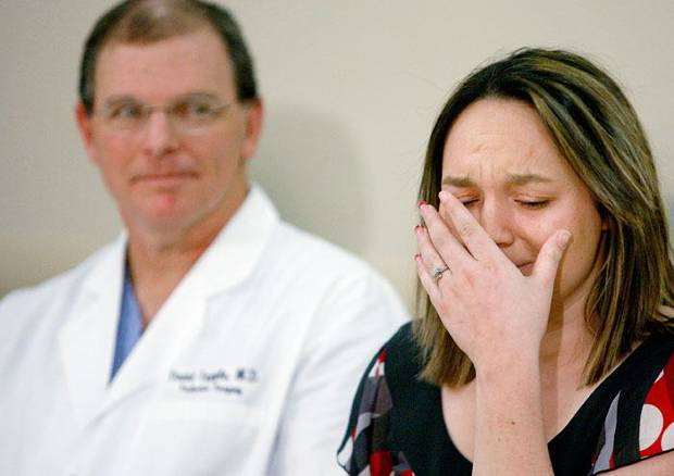 Stevie Stewart, mother of the conjoined twins Kylee and Preslee Wells who were separated by surgery earlier this week, is overcome with emotion as she speaks beside chief pediatric surgeon Dr. David Tuggle during a press conference in Oklahoma City, Thursday, Jan. 22, 2009. PHOTO BY BRYAN TERRY, THE OKLAHOMAN