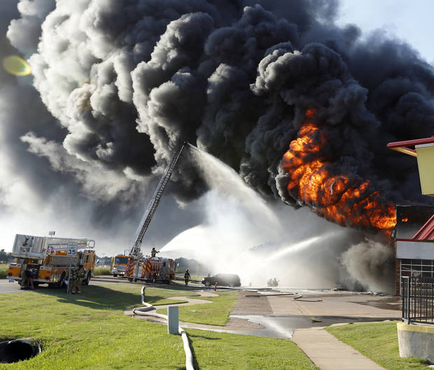 Firemen work to put out a fire at the Hibdon Tires Plus, 501 North Interstate Drive on Sunday, Aug. 25, 2013  in Norman, Okla. Photo by Steve Sisney, The Oklahoman
