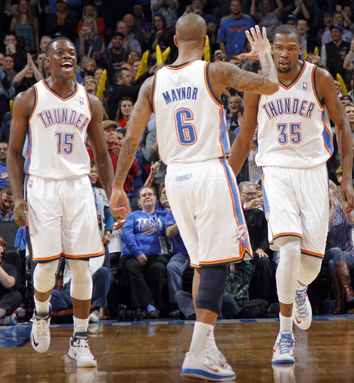 Oklahoma City Thunder's Reggie Jackson (15), Eric Maynor (6) and Kevin Durant (35) reacts after a shot made by Durant during the NBA basketball game between the Oklahoma CIty Thunder and the New Orleans Hornets at the Chesapeake Energy Arena on Wednesday, Dec. 12, 2012, in Oklahoma City, Okla.   Photo by Chris Landsberger, The Oklahoman