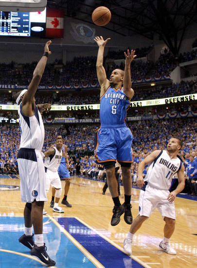 Oklahoma City's Eric Maynor (6) shoots the ball from between Brendan Haywood (33) and Jose Juan Barea (11) of Dallas during game 2 of the Western Conference Finals in the NBA basketball playoffs between the Dallas Mavericks and the Oklahoma City Thunder at American Airlines Center in Dallas, Thursday, May 19, 2011. Photo by Bryan Terry, The Oklahoman