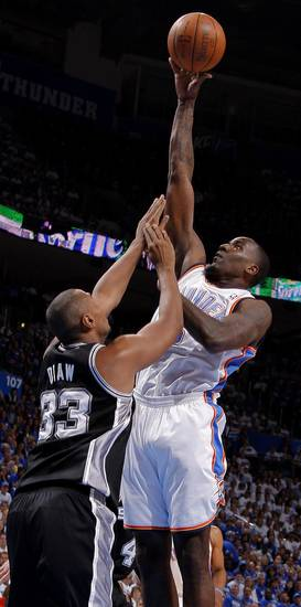 Oklahoma City's Kendrick Perkins (5) shoots the ball over San Antonio's Boris Diaw (33) during Game 4 of the Western Conference Finals between the Oklahoma City Thunder and the San Antonio Spurs in the NBA playoffs at the Chesapeake Energy Arena in Oklahoma City, Saturday, June 2, 2012. Photo by Bryan Terry, The Oklahoman