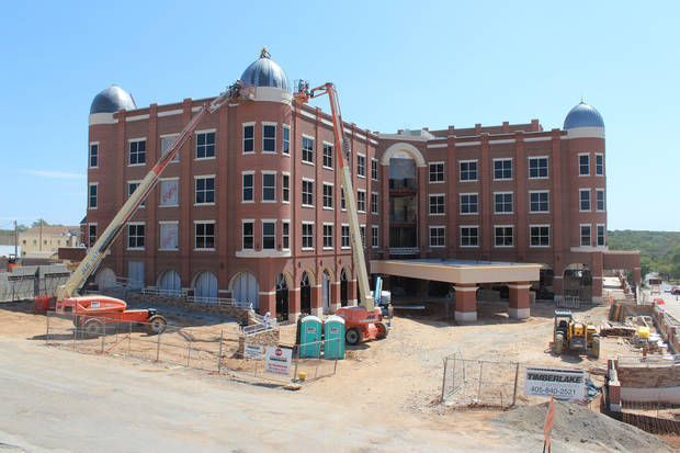 Construction continues at the site of the new Artesian Hotel in Sulphur.  PHOTO PROVIDED