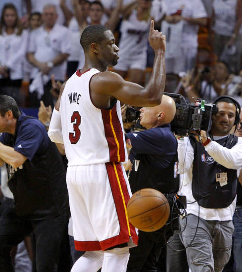 Miami's Dwyane Wade (3) celebrates after Game 4 of the NBA Finals between the Oklahoma City Thunder and the Miami Heat at American Airlines Arena, Tuesday, June 19, 2012. Oklahoma City lost 104-98.  Photo by Bryan Terry, The Oklahoman