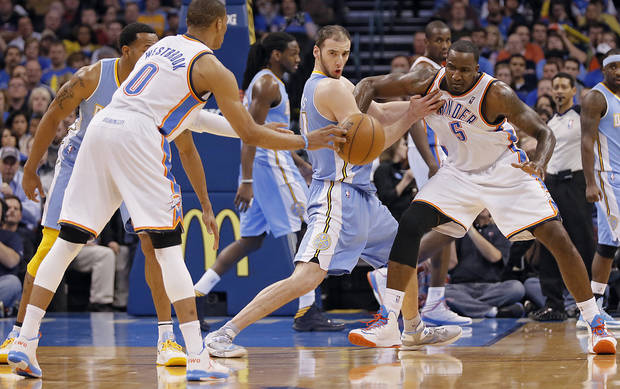 Oklahoma City's Kendrick Perkins (5) battles for space with Denver's Kosta Koufos (41) during the NBA basketball game between the Oklahoma City Thunder and the Denver Nuggets at the Chesapeake Energy Arena on Wednesday, Jan. 16, 2013, in Oklahoma City, Okla.  Photo by Chris Landsberger, The Oklahoman