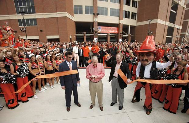 OSU coach Mike Gundy and OSU president Burns Hargis watch as Boone Pickens cuts the ribbon to officially open the new stadium before the college football game between OSU and the University of Georgia at Boone Pickens Stadium on the campus of Oklahoma State University in Stillwater Saturday, Sept. 5, 2009. Photo by Doug Hoke, The Oklahoman. ORG XMIT: KOD