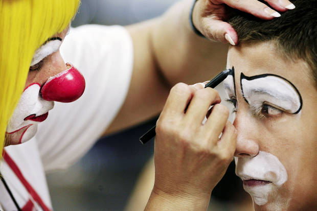 Joe Epperson, 13,  has makeup applied by makeup class instructor Mizz Klown  at Camp Funnybone at Heritage Hall School in northwest Oklahoma City Tuesday, June 19, 2007. When not a clown, Mizz Klown is Connie Kennedy.   By Jim Beckel,  The Oklahoman