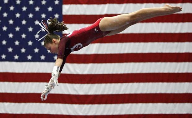 Abby Hoffman, 12, of  Jenks Gymnastics competes on the bars during the Nadia Comaneci International Invitational at the Cox Convention Center in Oklahoma City, Friday, Feb. 11, 2011.  Photo by Bryan Terry, The Oklahoman ORG XMIT: KOD