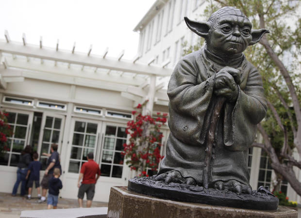 FILE - In this Aug. 2, 2011 photo, a life-sized replica of Yoda, George Lucas� master of the Force, is shown at Lucasfilm Ltd. production studios in San Francisco.  Lucas is moving forward with plans to build a park complete with a statue of Yoda and Indiana Jones in his Marin County hometown of San Anselmo, Calif. Lucas has applied for a permit to demolish the existing buildings at the site. (AP Photo/Paul Sakuma, File)