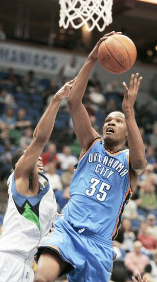 Thunder forward Kevin Durant, right, scored 30 points against Minnesota on Sunday. AP photo