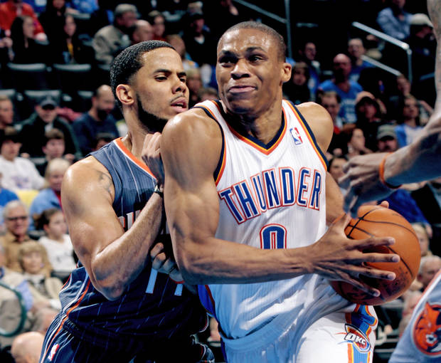 Oklahoma City Thunder's Russell Westbrook (0) drives past Charlotte Bobcats' Cory Higgins during the second half of the NBA basketball game as the Oklahoma City Thunder defeat the Charlotte Bobcats at 122-95 at the Chesapeake Energy Arena in Oklahoma City, Saturday, March 10, 2012. Photo by Steve Sisney, The Oklahoman