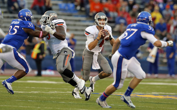 Oklahoma State's J.W. Walsh (4) looks to throw a pass during the college football game between Oklahoma State University (OSU) and the University of Kansas (KU) at Memorial Stadium in Lawrence, Kan., Saturday, Oct. 13, 2012. Photo by Sarah Phipps, The Oklahoman