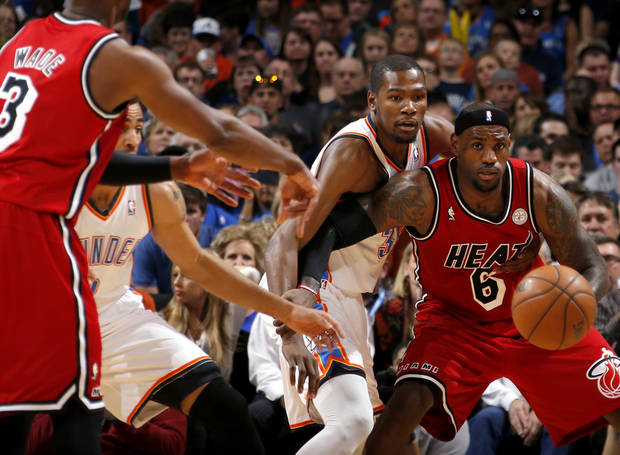 Miami's LeBron James (6) waits for the pass as Oklahoma City's Kevin Durant (35) defends during an NBA basketball game between the Oklahoma City Thunder and the Miami Heat at Chesapeake Energy Arena in Oklahoma City, Thursday, Feb. 15, 2013. Photo by Bryan Terry, The Oklahoman
