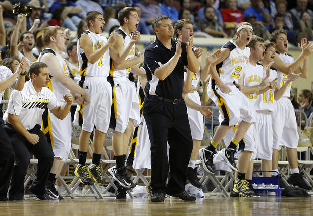 The Arnett team celebrates behind coach Allen Tune during the Class B boys state championship game between Coyle and Arnett in the State Fair Arena at State Fair Park in Oklahoma City, Saturday, March 2, 2013. Photo by Bryan Terry, The Oklahoman
