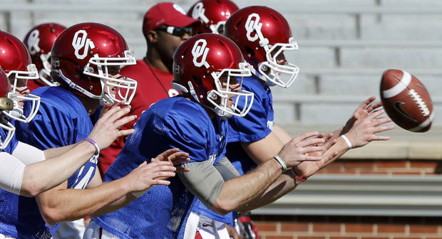 Quarterbacks including Cody Thomas and Trevor Knight go through drills as the University of Oklahoma Sooners (OU) begin spring practice on Owen Field at Gaylord Family-Oklahoma Memorial Stadium in Norman, Okla., on Tuesday, March 11, 2014. Photo by Steve Sisney, The Oklahoman