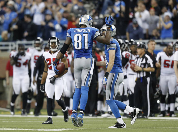 Detroit Lions wide receiver Calvin Johnson (81) is congratulated by a teammate in the fourth quarter of an NFL football game against the Atlanta Falcons, after breaking Jerry Rice's record for single-season receiving yards, in Detroit, Saturday, Dec. 22, 2012. (AP Photo/Rick Osentoski)