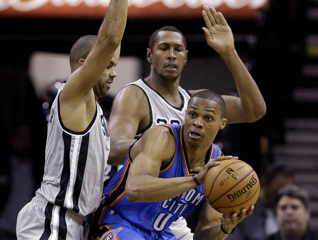 Oklahoma Thunder's Russell Westbrook (0) is pressured by San Antonio Spurs' Tony Parker, left, of France, and Boris Diaw, center, of France, during the first quarter of an NBA basketball game, Thursday, Nov. 1, 2012, in San Antonio. (AP Photo/Eric Gay) ORG XMIT: TXEG109