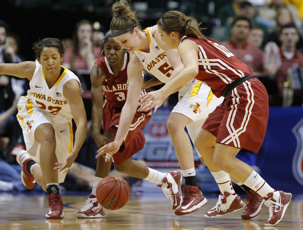 Iowa State's Hallie Christofferson (5) and Brynn Williamson (22) go for the ball between Oklahoma's Aaryn Ellenberg (3) and Morgan Hook (10) during the Big 12 tournament women's college basketball game between the University of Oklahoma and Iowa State University at American Airlines Arena in Dallas, Sunday, March 10, 2012.  Photo by Bryan Terry, The Oklahoman