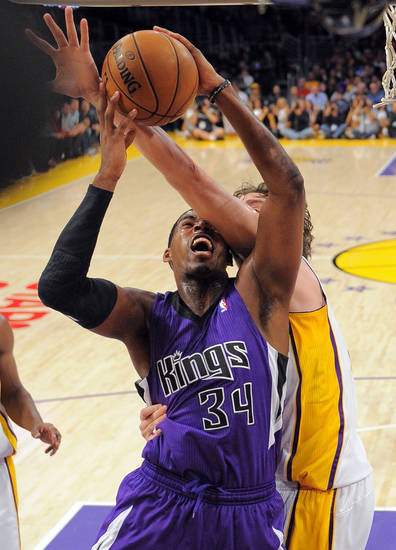 Sacramento Kings forward Jason Thompson, left, puts up a shot as Los Angeles Lakers forward Pau Gasol, of Spain, defends during the first half of their NBA basketball game, Sunday, Nov. 11, 2012, in Los Angeles. (AP Photo/Mark J. Terrill)