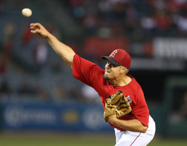 Los Angeles Angels starting pitcher Joe Blanton delivers in the first inning of an exhibition spring training baseball game against the Los Angeles Dodgers in Anaheim, Calif., Thursday, March 28, 2013. (AP Photo/Christine Cotter)