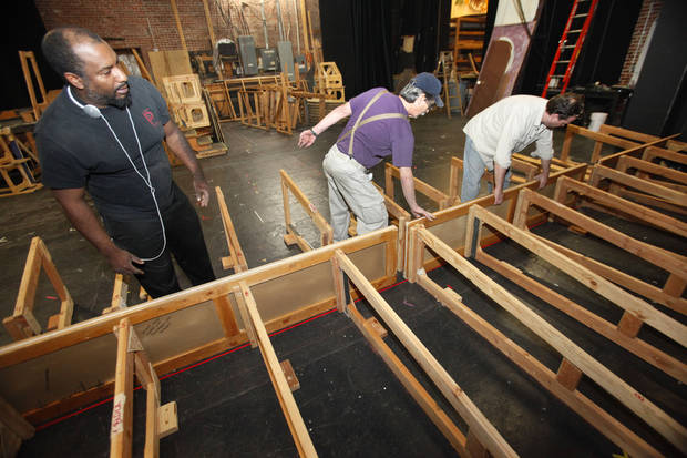 Pollard Theatre Artistic Director Jerome Stevenson, Lance Reese and Timothy Steward work on the set for the �A Territorial Christmas Carol� production that opens after Thanksgiving in Guthrie.  Photo By David McDaniel, The Oklahoman